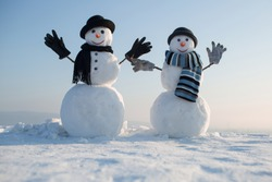 Christmas and winter fashion. New year snowman spy agent. Snowman gentleman in winter black hat, scarf and gloves. Happy holiday celebration. Xmas or christmas party.