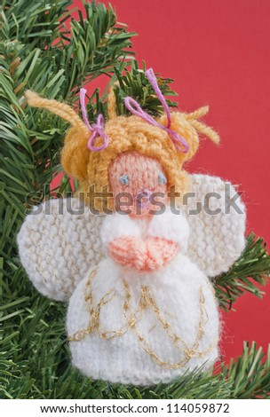 Knitting Pattern For Christmas Tree Angel : Christmas Angel Decoration Knitted. Home Made Knitted Angel Hanging On A Chri...