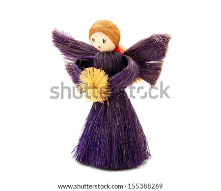 Christmas Angel tree decoration made from straw, isolated on a white background