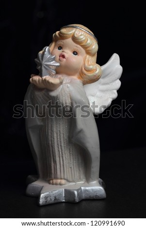 christmas angel with star over black