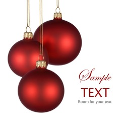 Christmas arrangement with three red baubles on pure white background for your text and/or design