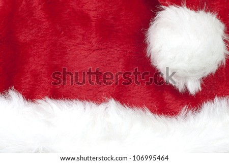 Christmas background against santa claus hat
