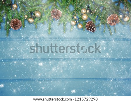 christmas background and cones decoration with fir branches on wooden board #1215729298