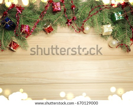 christmas background and decoration with fir branches copy space on wooden board #670129000