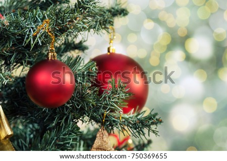 Christmas background - baubles and branch of spruce tree #750369655