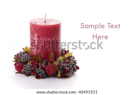 Christmas Background - Beautiful red candle isolated on white