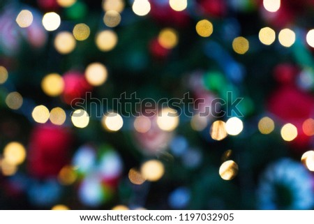 christmas background, blur colorful bokeh defocused lights decoration on christmas tree