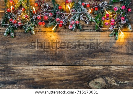 Christmas Background Border With Green Fir Branches Pine Cones Red Berries And Light On