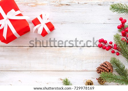 Christmas background - Christmas present red gifts box and decorating elements on white wooden background. Creative Flat layout and top view composition with border and copy space design.