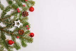 Christmas background, Christmas tree, red toys, cones, space for text