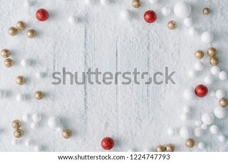 Christmas background composition with snow and decoration.New Year Flat lay. Top view.
