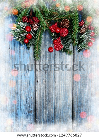 christmas background fir tree branch with cones and snow on wooden blue board #1249766827
