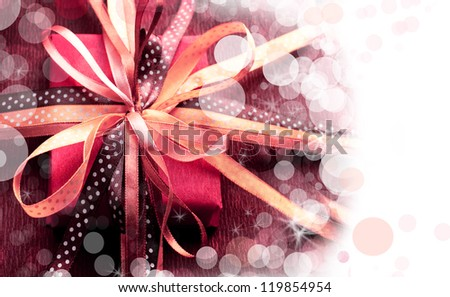 christmas background/ Holidays present with bow from atlas ribbon/ Romantic holidays gift