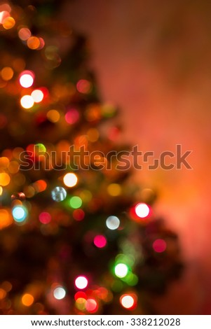 christmas background, image blur bokeh defocused lights decoration on christmas tree #338212028