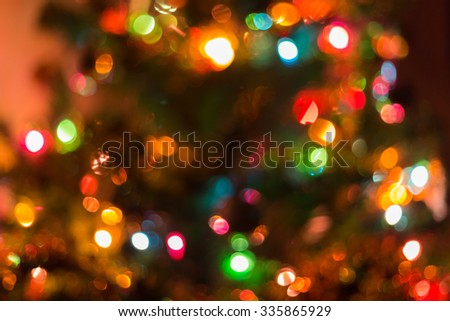 christmas background, image blur colorful bokeh defocused lights decoration on christmas tree #335865929