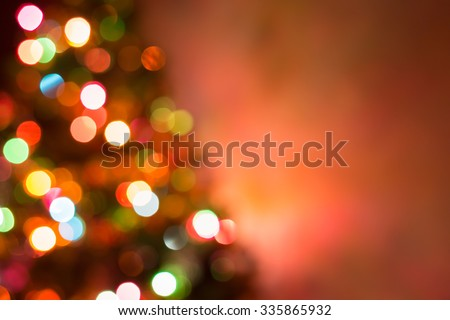christmas background, image blur colorful bokeh defocused lights decoration on christmas tree #335865932