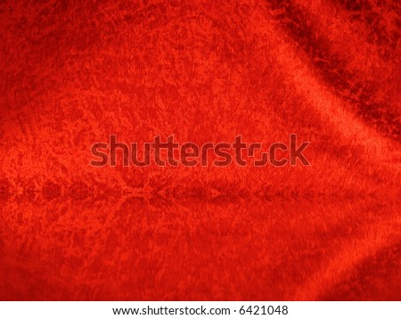Christmas background in red velcro with reflection