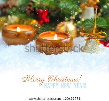 Christmas background is with candles on snow
