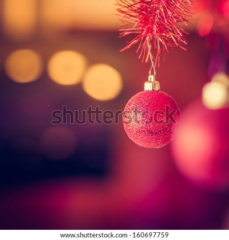 Christmas Background Made of a Red Ball and Beautiful Bokeh