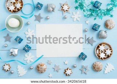 Christmas background, mockup, postcard or website header design with copyspace in the center on blue wooden table