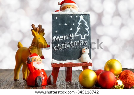 Christmas background of de-focused lights with decorated.space for text.(selective focus)