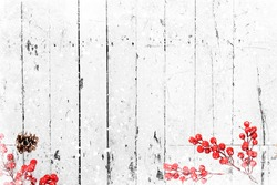 Christmas background - Old white wood texture with snow and holly berry. top view, border design. vintage and rustic style
