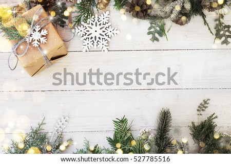 Christmas background on the white wooden desk - Shutterstock ID 527785516
