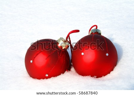 Christmas background, red Christmas balls on snow