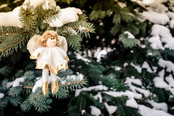 Christmas background Silver Angel in the branches of fir