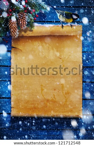 Christmas  background, snow covered old paper scroll