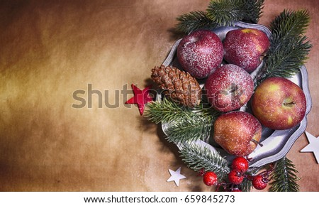 Stock Photo Christmas background, top view, apples on the lintage plate