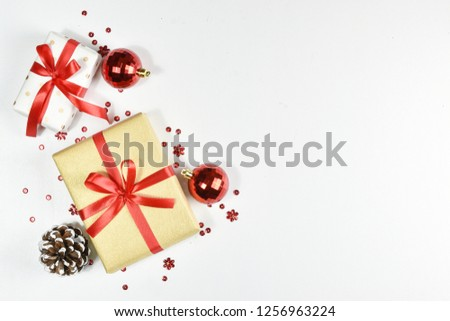 Christmas background. Top view of Christmas decorations. Flat lay of creative design on white background. Copy space for text. #1256963224