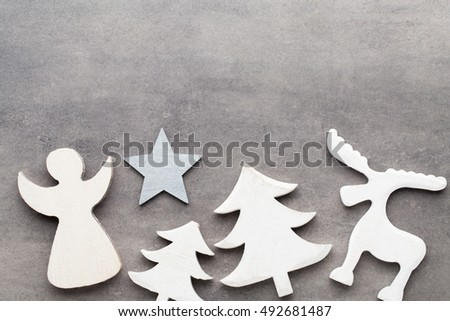Christmas background. White tree decorations on a gray background. Deer. Spruce. Star. Angel. #492681487