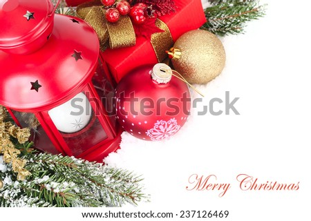 Christmas background with a red lamp and golden Christmas balls.