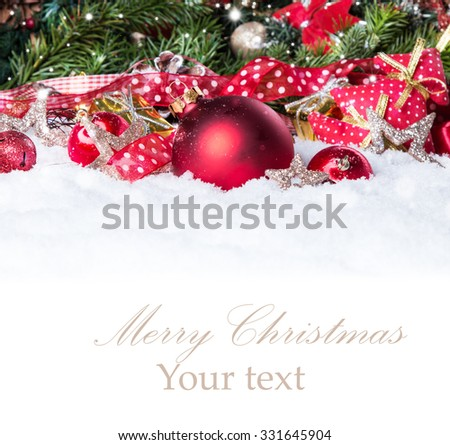 Christmas background with a red ornament on snow, Holiday decoration  #331645904