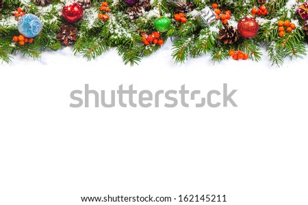 Christmas background with balls and decorations and snow, holly berry, cones isolated on white #162145211