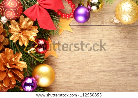 Christmas background with balls and decorations over wooden table