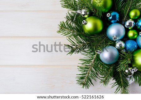 Stock Photo Christmas background with blue glitter ornaments. New year decoration with shiny bauble hanging. Copy space.