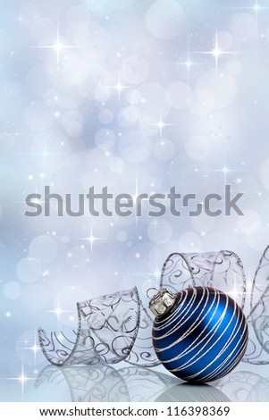 Christmas background with blue ornament and curled ribbon