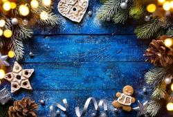 Christmas background with christmas cookies and festive decoration