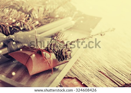 Christmas background with christmas decorations and gift / toned pictures