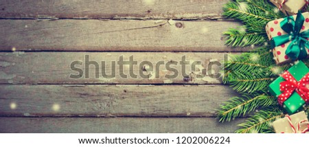 Christmas background with Christmas gift boxes on wooden board #1202006224