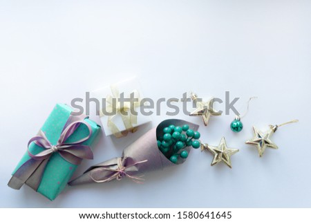 Christmas background with copyspace and gifts, stars, blue berries.