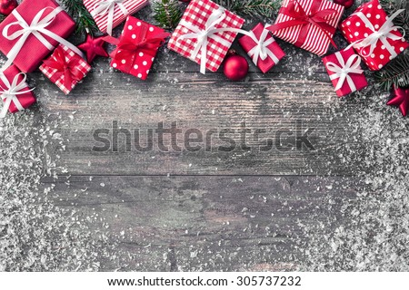 Shutterstock Christmas background with decorations and gift boxes on wooden board
