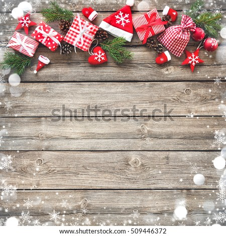 Christmas background with decorations and gift boxes on wooden board #509446372