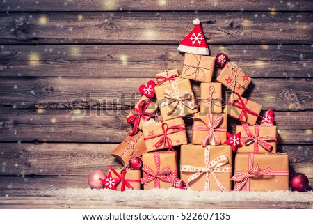 Christmas background with decorations and gift boxes on wooden board #522607135