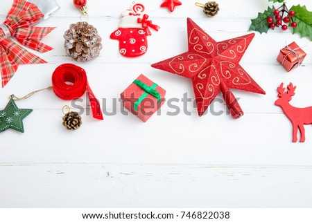 Christmas background with decorations and gift boxes on wooden board #746822038