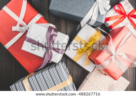 Christmas background with decorations and gift boxes on wooden board good photo #488267716