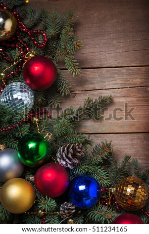 Christmas background with decorations  on wooden board #511234165