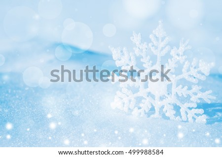 Christmas background with decorative snowflake on brilliant snow #499988584